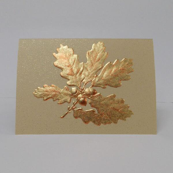 gold foil oak leaves on gold card 1000 pixels