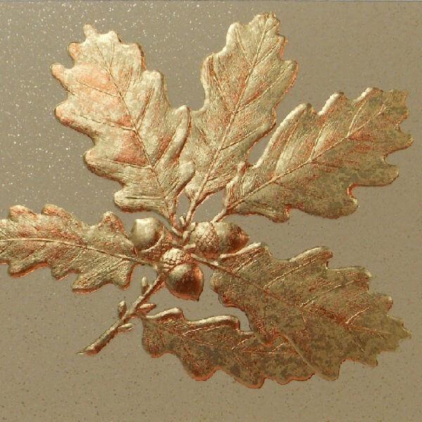 gold foil oak leaves on gold card closeup 1000 pixels
