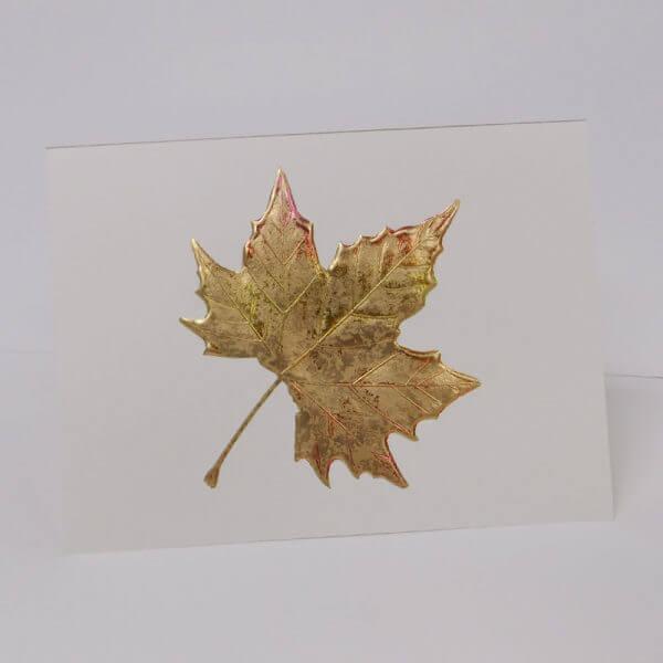 gold maple leaf on ecru card 1000 pixels