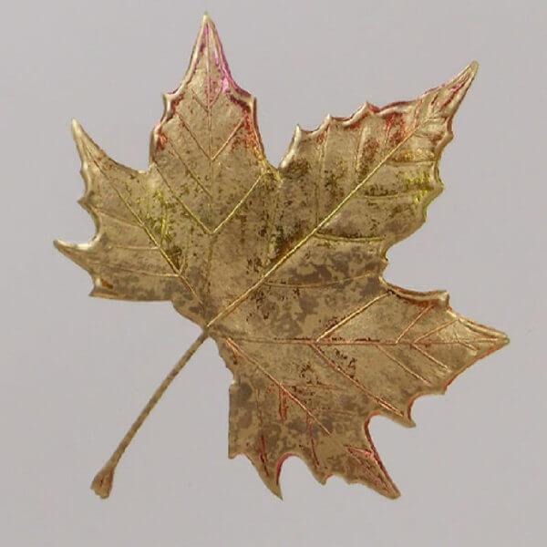 gold maple leaf on ecru card closeup 1000 pixels