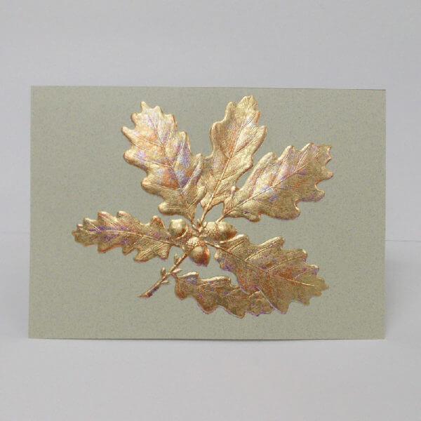 gold oak leaves on moss 1000 pixels