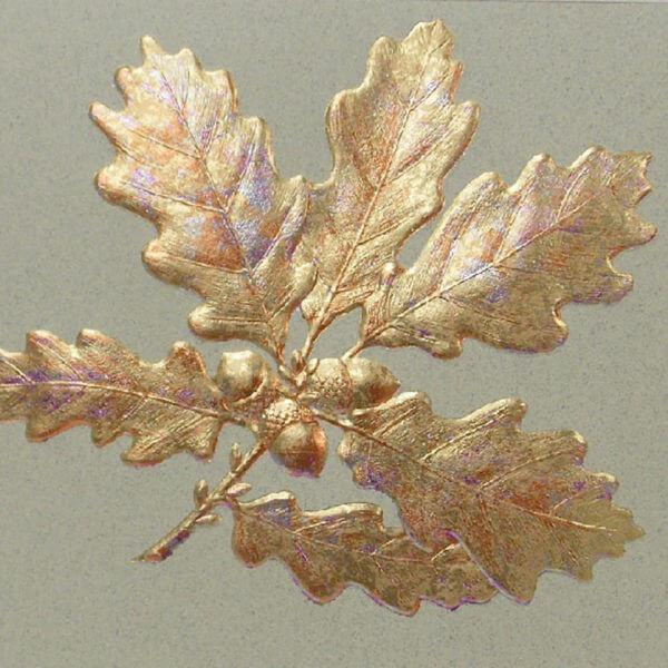 gold oak leaves on moss closeup 1000 pixels