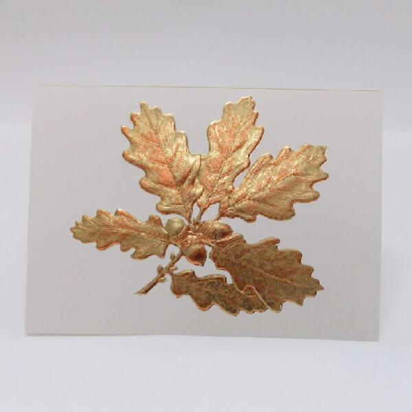 Gold oak leaf on ecru card 1000 pixels