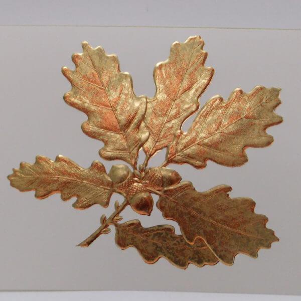 Gold oak leaf on ecru closeup 1000 pixels