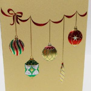 Paula Skene Designs hanging ornaments on gold Christmas card